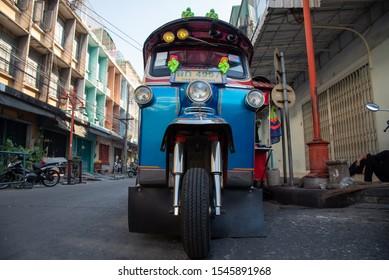 BANGKOK, THAILAND - FEBRUARY 21, 2017: Typical blue and shiny bangkoker tuktuk on a street in China Town downtown