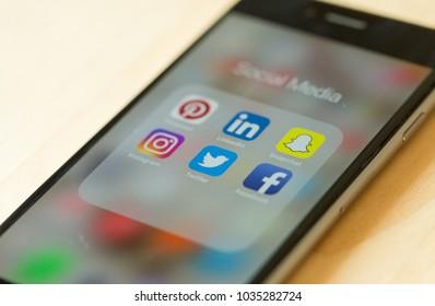 Bangkok, Thailand - February 21, 2018: Social media applications display on screen of black Apple's iPhone 6