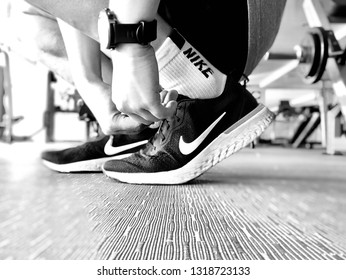 BANGKOK, THAILAND, FEBRUARY 21, 2019: The runner wears the black running shoes of NIKE Odyssey React.