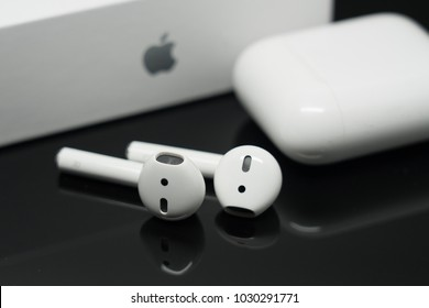 BANGKOK, THAILAND- FEBRUARY 21:View of  AirPods Wireless Bluetooth Headphones on the Table on February 21,2018