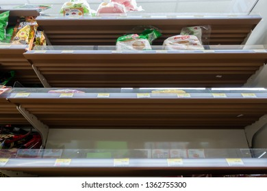 BANGKOK, THAILAND - FEBRUARY 22, 2019: Empty shelves of snack in 7-Eleven shop, Bangkok, Thailand. 7-Eleven is an international chain of convenience stores.