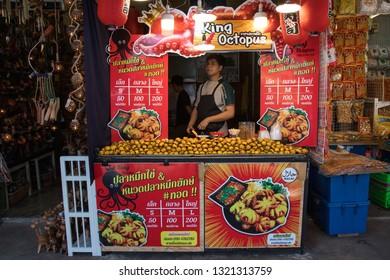 BANGKOK, THAILAND - February 23, 2019 : Thai Street Food, Fresh grilled squids for sale at Chatuchak weekend market, Bangkok Thailand.