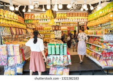 BANGKOK, THAILAND - February 23, 2019 : Chips fried durian and durian paste snack Placed on a shelf at Chatuchak weekend market Bangkok, Thailand.