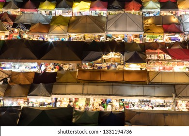 BANGKOK, THAILAND - February 23, 2019 : Market with colorful tents in night time, This is place in Thailand call Train Market, It is big market with a lot of foods and crowd people.