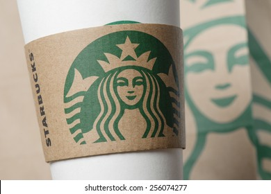 BANGKOK, THAILAND - FEBRUARY 26, 2015: Starbucks logo on sleeve. Starbucks is the world's largest coffee house with over 20,000 stores in 61 countries.