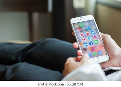 BANGKOK, THAILAND - February 26, 2017: Social media app icons on Iphone7 screen smartphone with mobile internet technology in digital lifestyle.