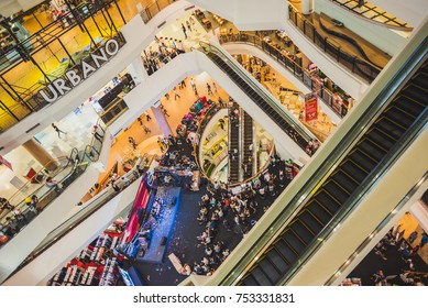 Bangkok, Thailand - February 26, 2017: Shopping mall Gateway interior with escalators and crowds of people.