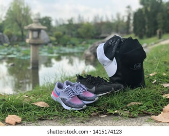 BANGKOK, THAILAND. FEBRUARY 26, 2019: the lovers wear running shoes Nike Odyssey React and Nike Zoom Fly FK.