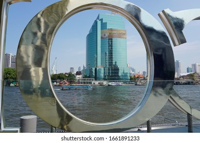 Bangkok / Thailand - February 27, 2020: The CAT Telecom Tower on the Chao Phraya River in Bangkok is one of many new skyscrapers that have been added to the urban skyline of Thailand's largest city.
