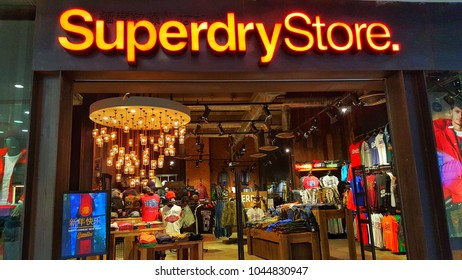 Bangkok - Thailand, February 28, 2018 : Luxury and fashionable brand window display. New collection of sportswear. Superdry shop at Emquatier Bangkok