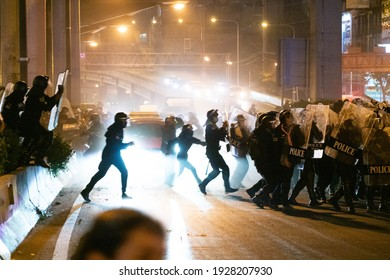 Bangkok, THAILAND - February 28, 2021: Thailand's pro-democracy protesters clash with riot police near PM's residence