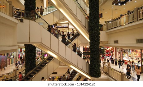 BANGKOK , THAILAND - February 3, 2019:Time Lapse Shopping mall crowd of people on Escalator.
