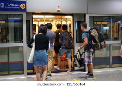Bangkok Thailand - February 4, 2018: The The passengers walking to the inside MRT subway train arrived in the rush hour, Transportation of the Bangkok Mass Rapid Transit