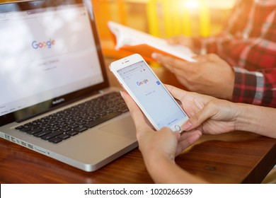 Bangkok. Thailand. February 5, 2018. Young woman holding a brand new iPhone with Google website on the screen. Google website is the first social media online. service for search.