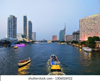 Bangkok, Thailand – February 6 , 2019 : Sapan Taksin bridge, Chao Phraya river of Thailand, Cat telecom building bangrak, ICONSIAM, Bangkok, Shangri-La Hotel Bangkok, Mandarin Oriental, Bangkok.