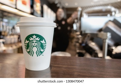 Bangkok ,Thailand - February 8 2019 : A cup of take home Starbucks espresso coffee on the table in the Starbucks coffee shop.