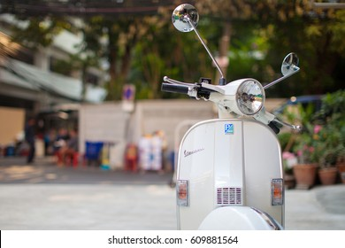Bangkok, Thailand - February 9, 2017 : The vintage white vespa stands parked near the street at February 9, 2017 in Bangkok, Thailand