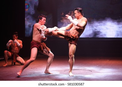 """Bangkok, Thailand - Febuary 13, 2017 ; Final Round of """"Mister International 11th"""" at Asiatique, Muay Thai Traditional Art Fighting of Thailand performance"""