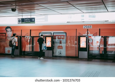 BANGKOK THAILAND FEBUARY 20, 2018: Passenger at BTS Skytrain station in Bangkok Thailand. BTS skytrain arrived and people line up for waiting on platform in rush hour.