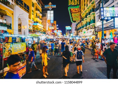 BANGKOK, THAILAND - FEBUARY 28, 2015: Tourist walking tour at Khaosan Road by night, a world famous backpacker district in Bangkok, Thailand