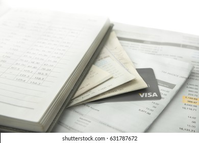 Bangkok, Thailand : Febuary 5, 2017 - Accounting book over bunch of generic credit transactions and billing with VISA credit card under the bills