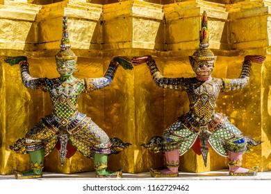 Bangkok, Thailand - grand palace - demons holding up temple