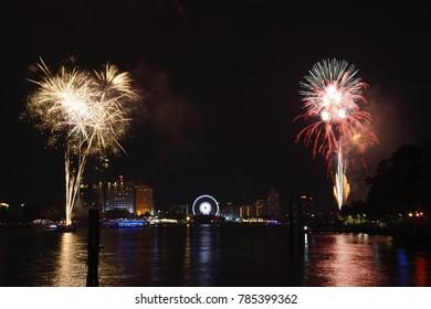 Bangkok, THAILAND - JAN 01:2018.Fireworks Happy New Year 2018 Chao Phraya River side In Bangkok Thailand.