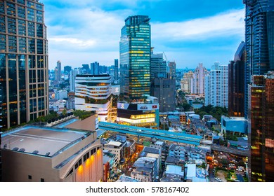 BANGKOK, THAILAND - JAN 10, 2017: The Emquartier Shopping Mall with the view of  Bangkok Skyline on Sukhumvit road.