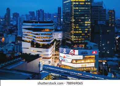 BANGKOK, THAILAND - JAN 10, 2017: Night shot of The Emquartier Shopping Mall on January 10, 2017 with the view of Bangkok Skyline on Sukhumvit road.