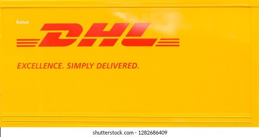 Bangkok, THAILAND - JAN 12: Beside of DHL truck on Jan 12,2019 in Bangkok, Thailand. DHL Express is a division of the German logistics company. Red and Yellow is a brand color of DHL.