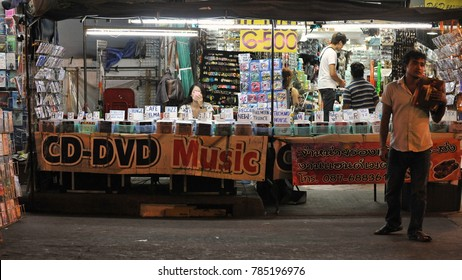 Bangkok, Thailand - Jan 14, 2013: A store sells pirated CDs and DVDs on Khao San Road. Thailand is notorious for its bootlegged software and media content, and is on the US pirated goods watchlist.