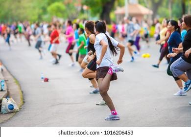 BANGKOK, THAILAND - JAN 3: People doing aerobic dance after work for exercise at Lumpini Park on January 3, 2017 in Bangkok, Thailand.