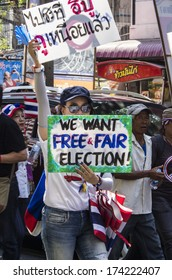 Bangkok, Thailand - Jan30, 2014: Anti-government protesters march along Sukhumvit road from On Nut to Pathumwan under the a campaign for national reform before the election.