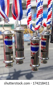 """Bangkok, Thailand - Jan30, 2014: Whistles and national flag tri-coloured ribbons, Tools and/or souvenirs of """"Bangkok Shutdown"""" for """"national reform before the election"""" protest."""