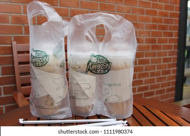 Bangkok, Thailand : Jane 13, 2018, Ice coffee in a bag of cafe'amazon on wooden table in cafe amazon