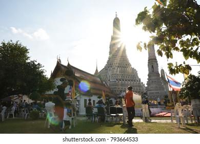 Bangkok, Thailand - January 01, 2018: Tourist at Temple complex of Wat Arun Buddhist temple in Bangkok, during sun set time