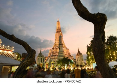 Bangkok, Thailand - January 01, 2018: Night view of Wat Arun Buddhist temple andTourist in motion blur form at Temple complex of Wat Arun Buddhist temple in Bangkok.