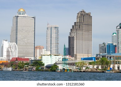 BANGKOK, THAILAND - JANUARY 01, 2019: The thrown skyscraper of Sathorn Unique Tower in a city landscape of modern Bangkok