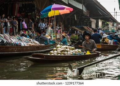 Bangkok, Thailand - January 02, 2011 : Damnoen Saduak floating market, famous attraction of Ratchaburi province, Thailand