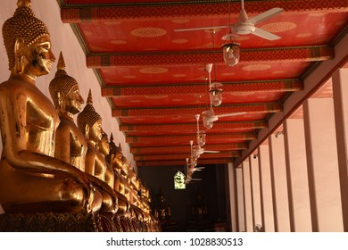 BANGKOK THAILAND - January 02, 2018:  Buddha gold statue in one line in Wat Pho temple in Thailand.