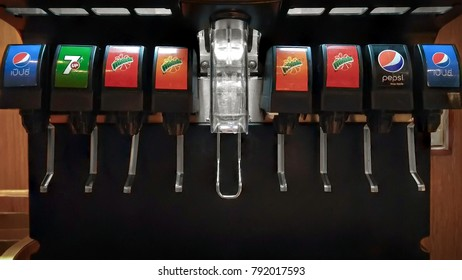 BANGKOK, THAILAND - JANUARY 02, 2018: Ice and soda dispensing machine with Pepsi, 7Up and Merlinda in operation