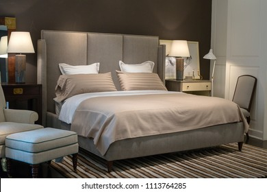 BANGKOK, THAILAND - JANUARY 07, 2016 : Stylish bedroom interior design with pillows on bed in supermarket Siam Paragon. Siam Paragon is a one of the biggest shopping centres in Asia