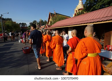 BANGKOK, THAILAND - January 1 2018: People make merit by offering food to monk at the temple.