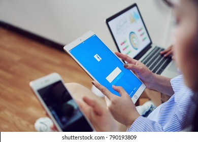 Bangkok, Thailand - January 10, 2018 : hand is pressing the Facebook screen on apple ipad pro,Social media are using for information sharing and networking.