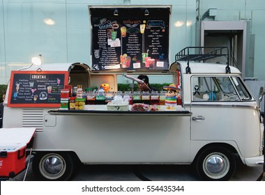 Bangkok, Thailand - January 11, 2017: Food trucks parking for orders by customer at food truck festival market.