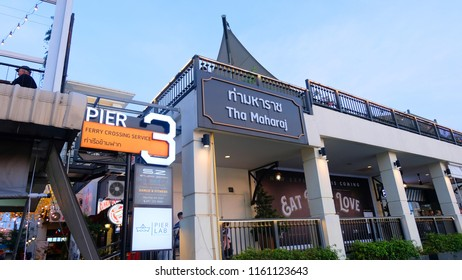Bangkok, Thailand - January 12, 2018 : Attraction holiday on river side, Landmarks Thailand, Perspective to Tha Maharaj shopping mall stick the Chao Phraya river.