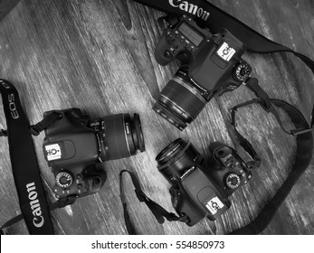 "BANGKOK, THAILAND - January 1,2017: Canon Eos 80D,Canon Eos 600D,Canon Eos 500D on Wooden background. Black&White, Topview. ""illustrative"" and ""editorial"""