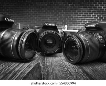 "BANGKOK, THAILAND - January 1,2017: Canon Eos 80D,Canon Eos 600D,Canon Eos 500D on Wooden background. Black&White. ""illustrative"" and ""editorial"""