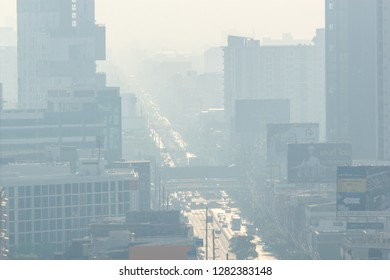 BANGKOK, THAILAND - January 13: Ladprao Intersection road on January 13,2019 in Bangkok, Thailand. Environmental pollution from PM2.5 (particles less than 2.5 micrometers diameter) spread in road air