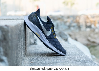 BANGKOK, THAILAND - JANUARY 13,2019 :Nike Air Zoom Pegasus 35 Men's Running Shoes BLACK/MTLC PEWTER color  on concrete stone floor outdoor. Nike is a global sports clothes and running shoes retailer
